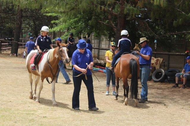 Children demonstrate what they have achieved through their therapeutic riding lessons at Sarda